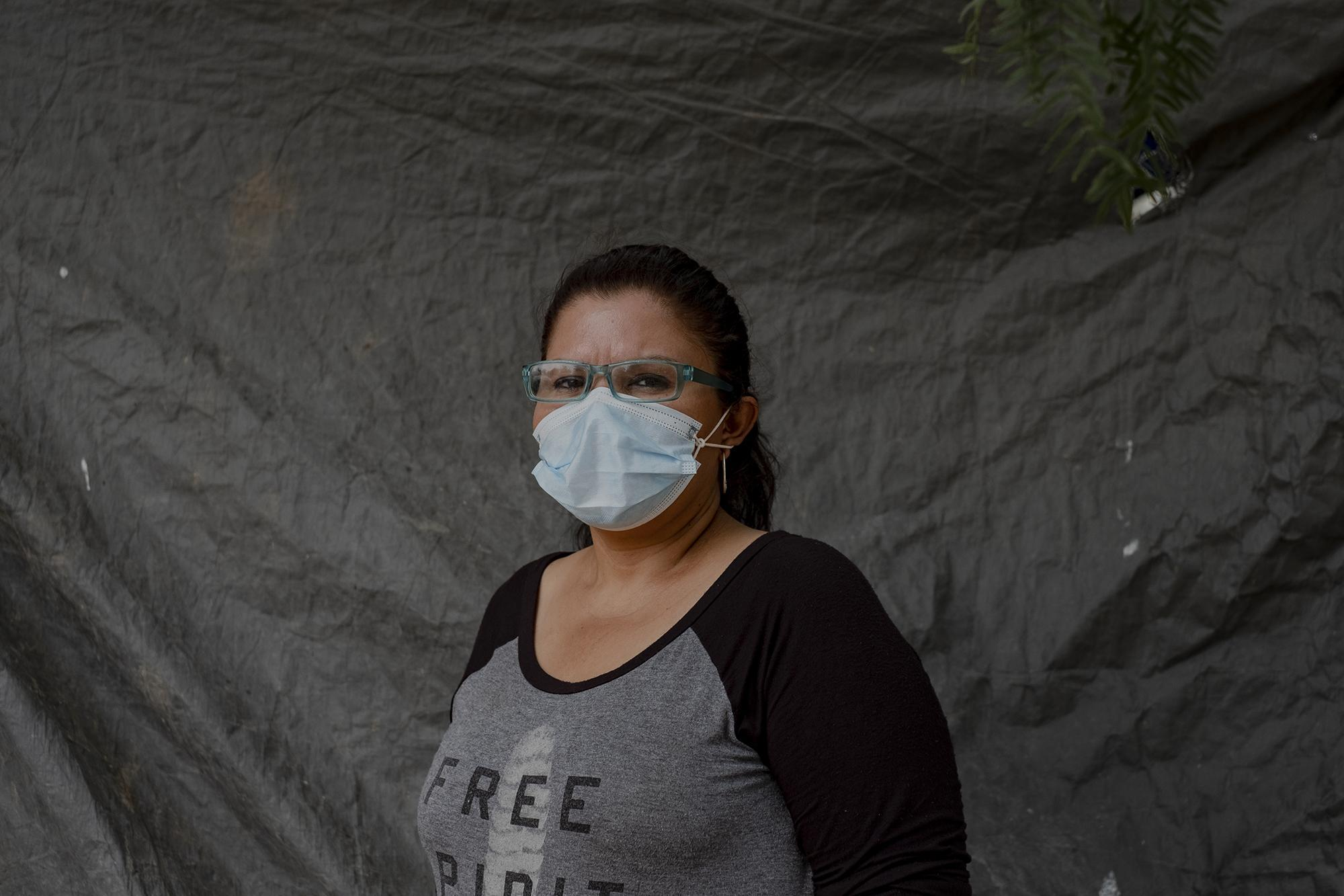Perla Vargas, a Nicaraguan who is fleeing from Daniel Ortega's regime. She lives among a cluster of shacks in a tent with her family. She is hopeful that the United States will grant her asylum, as she says she has evidence supporting her case and a very dedicated lawyer. She is also in charge of the camp pharmacy. Photo from El Faro: Fred Ramos.